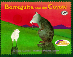 The book jacket shows a drooling gray coyote and a white little lamb in a meadow at the base of a mountain.