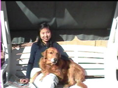 This is a photograph of Xiaolin and her dog