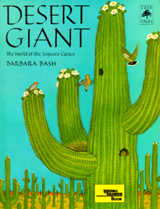 The book jacket shows a blooming saguaro with birds nesting and hovering.