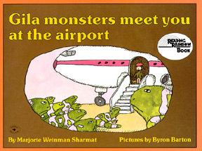 The book jacket shows gila monsters meeting an airplane passenger.