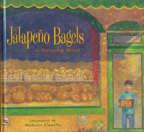The cover of the book shows Pablo holding an open sign in the door of his parents' bakery.