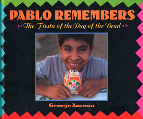 The book jacket is a photograph of a Oaxacan boy holding a sugar skull.