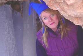 This is a photo of Jackie peeking out of an ice cave in Bryce Canyon.
