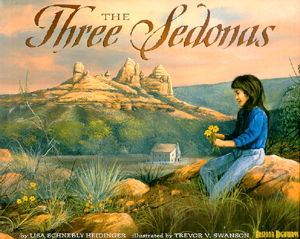 The book jacket shows a young girl playing with flowers with the towering red rocks in the background.  The sky is ablaze with colors.