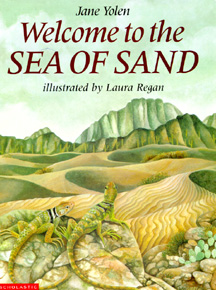 The book jacket shows lizards looking out on a sea of sand.